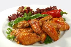 Chicken wings. Fried chicken wings in friture with red pepper Royalty Free Stock Photography