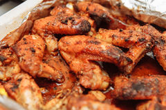 Chicken wings baked in foil in honey sauce. Chicken wings baked in the oven in honey sauce stock image