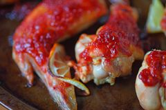 Baked chicken wings closeup royalty free stock photography