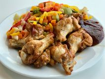 Chicken Wings with Barbecue Sauce and Vegetables Ready to Serve with Plate at Restaurant. royalty free stock images