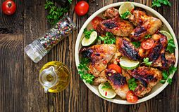 Chicken wings of barbecue in sweetly sour sauce. Picnic. Summer menu. Tasty food. Top view. Flat lay royalty free stock images