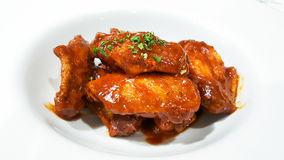 Chicken wings. With barbeque sauce stock images