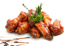 Chicken wings with barbeque sauce. On white Royalty Free Stock Photos