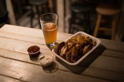 Chicken wings, beer, sauces on the table in the pub. Looking good Stock Photo