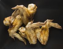 Chicken wings on black background Royalty Free Stock Images
