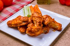 Chicken wings with blue cheese sauce royalty free stock images