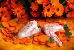Chicken wings with carrots. Raw chicken wings with carrots vegetables amazing orange arrangement parsley, spices Stock Photo