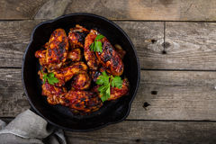 Chicken wings in cast iron skillet Stock Image