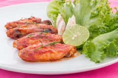 Chicken wings with cayenne pepper sauce. On white plate Royalty Free Stock Images