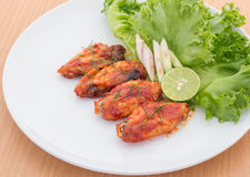 Chicken wings with cayenne pepper sauce. On wooden background Royalty Free Stock Image