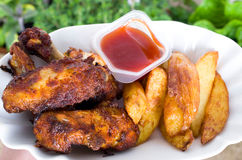 Chicken wings and chips Royalty Free Stock Photos