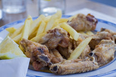 Chicken wings with chips Stock Photo