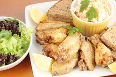 Chicken wings, coleslaw and a side salad Stock Photo