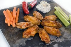 Chicken wings and condiments Royalty Free Stock Photo