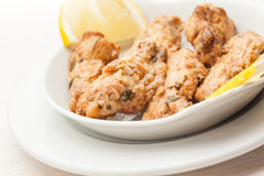 Chicken wings with coriander, garlic and lemon Stock Photography
