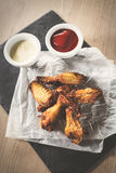 Chicken wings. Delicious crispy chicken wings with sauce and beer. Top view, vintage Royalty Free Stock Photo