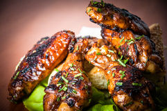 Chicken wings. Delicious chicken wings and lettuce, close up Stock Photography