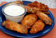 Chicken Wings and Dip. Full plate of spicy chicken wings with dip on the side Stock Photo