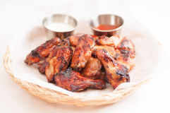 Chicken wings with dip. Hot and spicy chicken wings with dip and hot sauce Stock Image