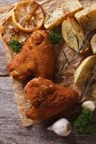Chicken wings dipped in batter, with potato top view, vertical Royalty Free Stock Image