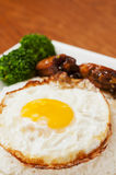 Chicken wings  and  egg Stock Image