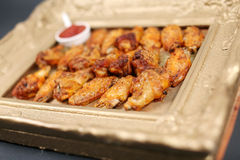 Chicken wings in a frame Royalty Free Stock Photo