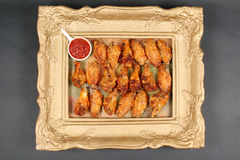 Chicken wings in a frame Royalty Free Stock Image