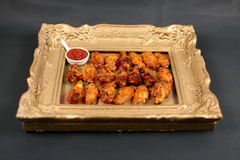 Chicken wings in a frame Royalty Free Stock Images