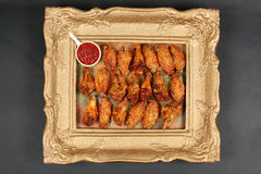 Chicken wings in a frame, view from above Stock Photo