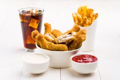 Chicken wings, french fries, coke and sauces Royalty Free Stock Image