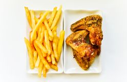 Chicken wings with french fries stock photo
