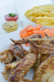 Chicken wings with french fries,sauce and vegetables Royalty Free Stock Photography