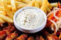 Chicken wings and french fries, snacks royalty free stock photography