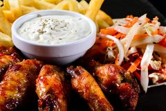Chicken wings and french fries, snacks stock photos