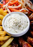 Chicken wings and french fries, snacks royalty free stock image