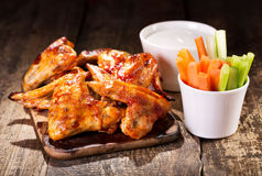 Chicken wings with fresh vegetables and sauce Royalty Free Stock Image