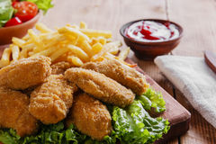 Chicken wings fried in breadcrumbs with sauce  and french fries Royalty Free Stock Image