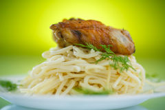 Chicken wings fried with noodles Stock Photos