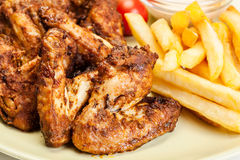 Chicken wings with fries french and spicy sauce Stock Photography