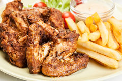 Chicken wings with fries french and spicy sauce Royalty Free Stock Photo