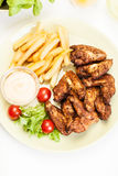 Chicken wings with fries french and spicy sauce Royalty Free Stock Images