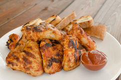 Chicken wings on grill Royalty Free Stock Photography