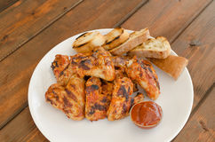 Chicken wings on grill Stock Photos