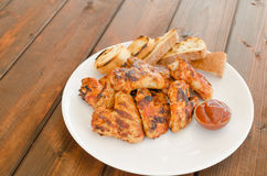 Chicken wings on grill Royalty Free Stock Photos