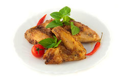 Chicken wings a grill with a tomato Royalty Free Stock Photo
