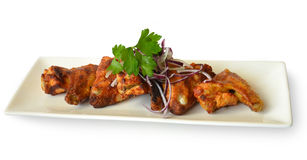 Chicken wings grilled with herbs on a white  background Stock Photo