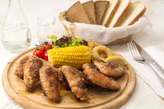 Chicken wings are grilled Stock Photos