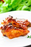 Chicken wings with honey sauce Stock Photos