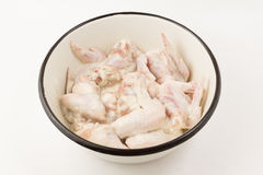 Chicken wings in marinade Stock Photo