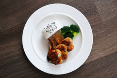 Chicken wings. Marinated and then baked in the oven. Rice and blanched broccoli royalty free stock image